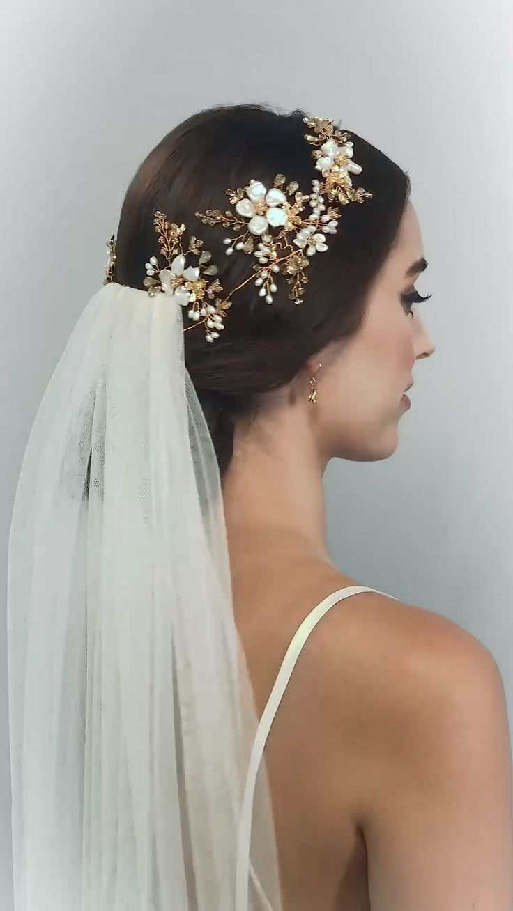 Hermione Harbutt gold and pearl flower crown Floriana Garland with veil. Hermione Harbutt Video Shoot 2019. Hair by Becks of Thairapy. Make Up by Kayleigh K MUA. Model Alexa Taylor. Gown by Suzanne Neville. Accessories by Hermione Harbutt. Video by Richard Cambridge Harbutt.