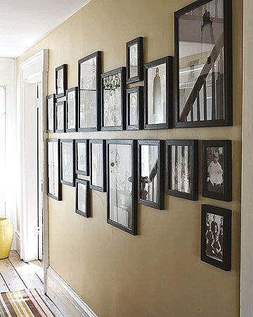 una solución elegante para colgar fotos en el pasillo