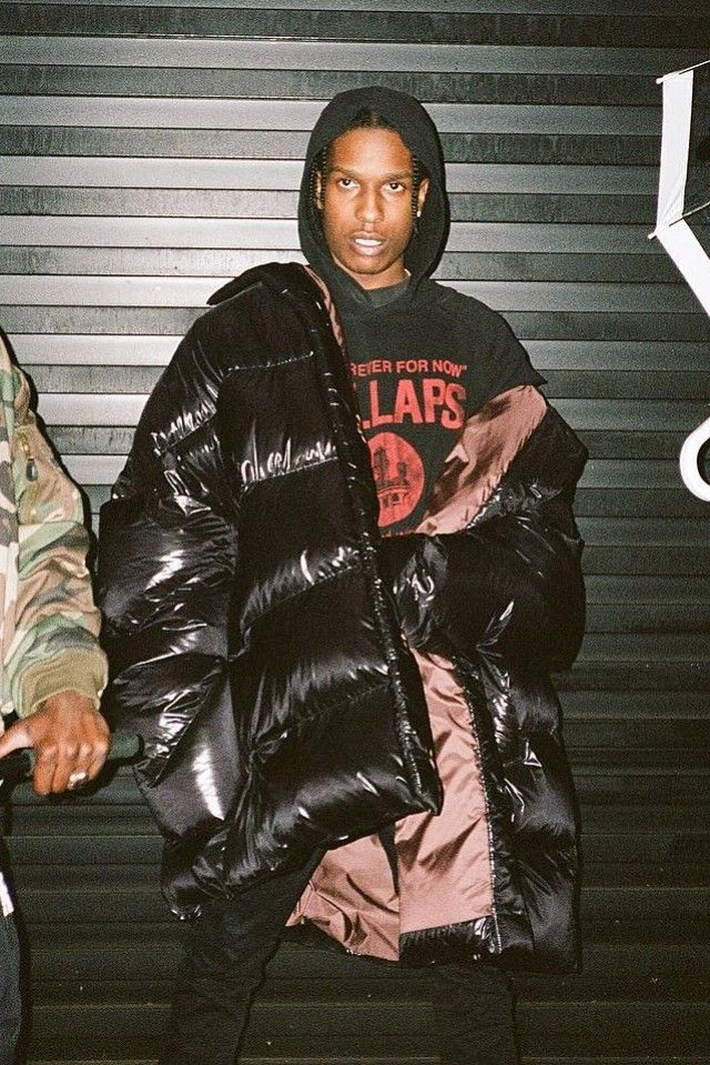 ASAP Rocky wearing  Raf Simons SS 02 Kollaps Hoodie, Raf Simons Oversized Down-Quilted Coat