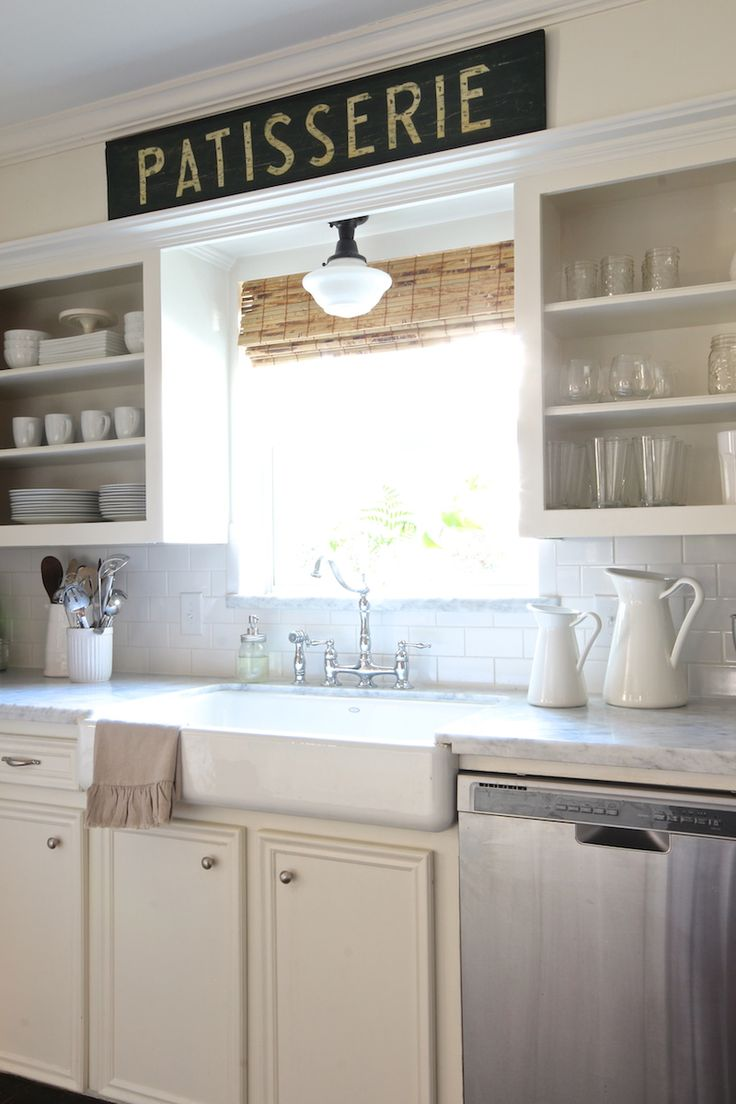 Open shelving, farmhouse sink, bridge faucet, schoolhouse light, carrara marble - love this beautiful & classic kitchen