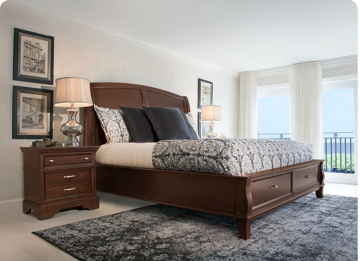A cherry wood bed and nightstand warms your bedroom with lasting style.