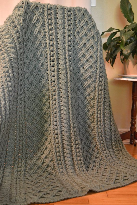 Enjoy the rich texture of this handmade aran style afghan that showcases the stunning lattice weave stitch. Also featured are large and small