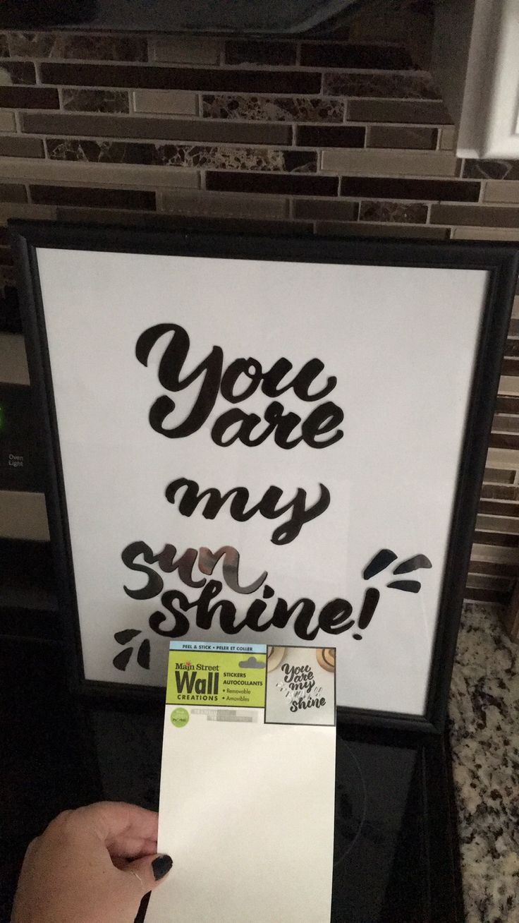 Dollar Tree DIY , use one one their frames, flip over the paper insert and use the white side. Clean glass with rubbing alcohol then apply Dollar Tree wall art stickers