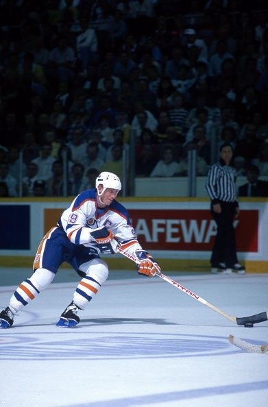 Wayne Gretzky of the Edmonton Oilers skates with the puck during a game in the…