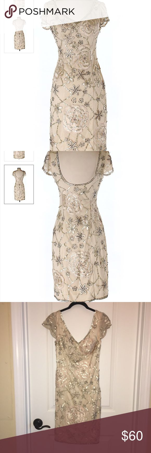 """Sue Wong Embroidered/Embellished Dress size 2 Sue Wong cocktail dress, size 2. Champagne colored dress with embroidery and beading/sequin embellishments. Few areas of loose threads, missing embellishments (see pics). Overall in very good used condition. Concealed side zipper. 100% nylon. A-line silhouette. Approx 32"""" in length. Please ask any questions! Sue Wong Dresses"""