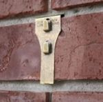 """If you are wondering how to hang a wreath, Christmas decorations, Christmas stockings, pictures, and other decor on your brick fireplace or brick wall outside, we have the solution. Use the brick clip indoors or outside. Each clip supports 25 lbs. The clip goes on and off the brick easily. There are no holes or tools needed. There is no damage to the brick. Clips do not work on bricks where the mortar is weeping. Brick needs to extend 1/8"""" from mortar."""
