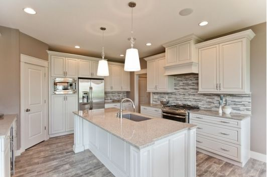 Kitchen with white cabinets and white island-Home and Garden design ideas