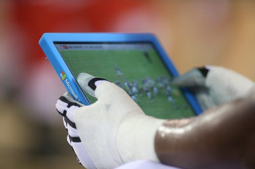 A player uses a Microsoft Surface Tablet on the sideline during an NFL football game between the Jacksonville Jaguars and the Tampa Bay Buccaneers at EverBank Field on Saturday, Aug. 20, 2016 in Jacksonville, FL. The Bucs won 27-21. (Perry Knotts via AP)