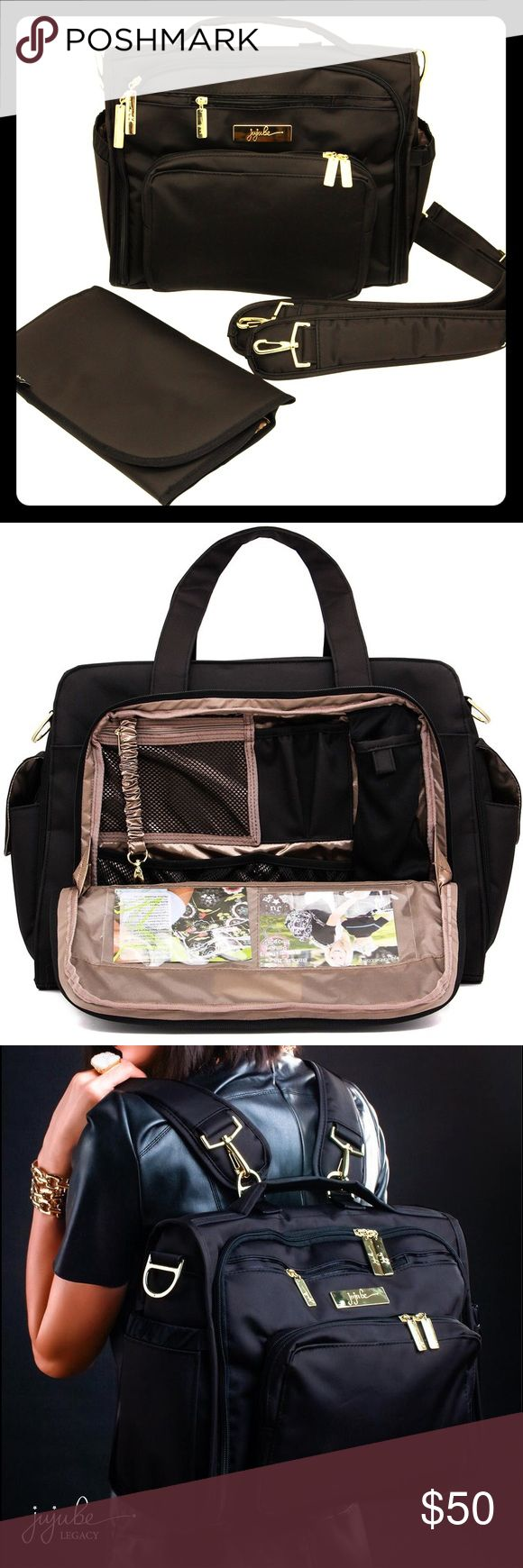 """Jujube diaper baby bag """"the monarch"""" I bought this diaper bag from Nordstrom less than a year ago and it's amazing -- lots of pockets inside and out, and a perfectly sized outside """"mom's pocket"""" that fits wallet, keys, sunglasses, lip gloss, pens, etc. Comes with a changing pad. Best feature is that it can be worn as a shoulder bag or backpack which is perfect for travel. If you're not familiar with this bag, check out more details online or the reviews on YouTube! This bag is used but still…"""