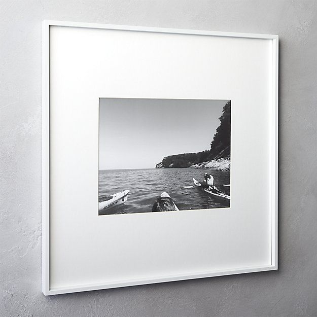 Shop gallery white picture frames.   Exhibit your favorite photos gallery-style.  Creating a display of modern proportions, oversized white mat floats within a sleek frame of bright white aluminum.