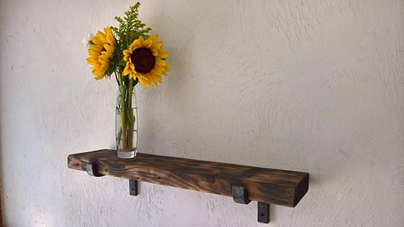 "Single Heavy duty steel bracket. 1"" wide by 3/8"" thick for a wooden shelf.  Choose either a natural raw metal or a hot waxed blackened finish."