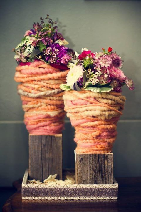 Make these out of wisteria vine, and then slather with cement.   Now they are pots . duett