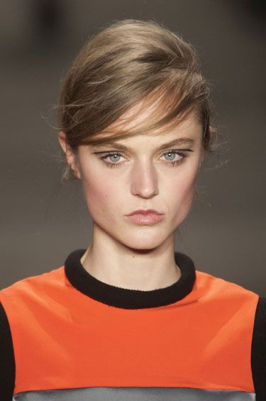 """Fall 2013 Side Faux Bang:  """"creating the low side part and sweeping the hair over the forehead gives the tom-boyish style a feminine feel."""" Models at Dries Van Noten and Marni had similarly wispy fringe; versions at Reem Acra and Tracy Reese were thicker, as bobby pins tucked behind the ears held chunky sections of hair in place."""
