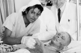 While recovering from the infamous Pepsi incident which burned his scalp, Michael Jackson visited fellow burn patients. This photo is of him with burn victim Keith Perry. Michael later donated the 1.5 million dollar settlement from Pepsi to Brotman Medical Center for the burn ward, which was later renamed The Michael Jackson Burn Center.
