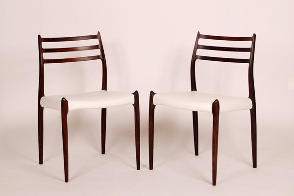 N.O. Møller Dining Chairs in rosewood model 78 Padded with white leather. Produced by J. L. Møller.
