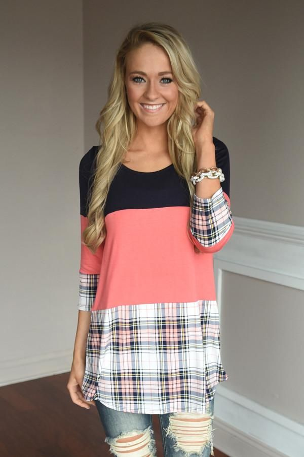 A cute combo of colors! Dark Navy on top, coral middle and plaid on the bottom! True to size w/a looser...