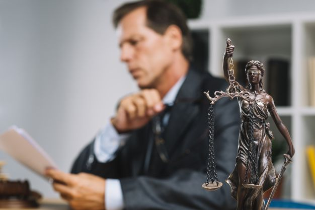 Download Professional Lawyer Reading Document With Justice Statue In Forefront For Free Justice Statue Graphic Design Tutorials Photoshop Statue