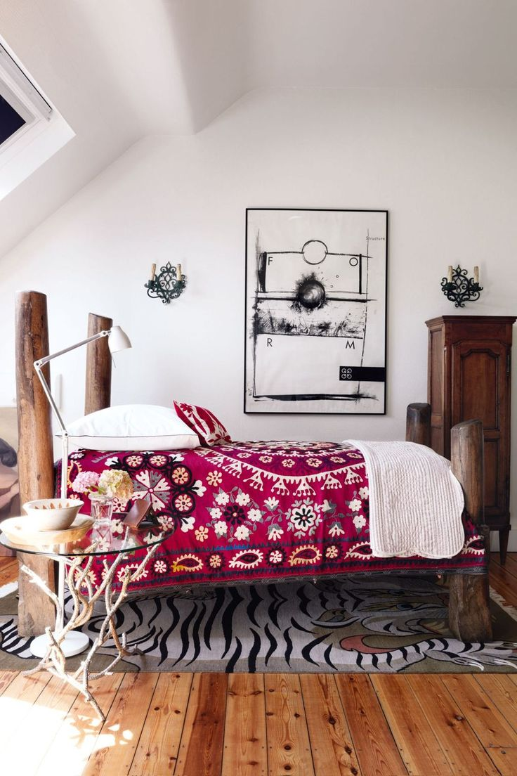 """This tiny [link url=""""http://www.houseandgarden.co.uk/interiors/loft-conversions""""]attic bedroom[/link] features a grand upcycled bed made from abandoned wooden mooring posts from Venice. It originally belonged to its owner Anne-Marie Midy's grandmother. [link url=""""http://www.houseandgarden.co.uk/interiors/white-room-ideas""""]White walls[/link] ensure that the [link url=""""http://www.houseandgarden.co.uk/interiors/interior-design-ideas-small-spaces-flats""""]small space[/link] does not feel too…"""