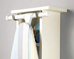 Great idea for holding an ironing board. I like this idea to hang in the laundry room!