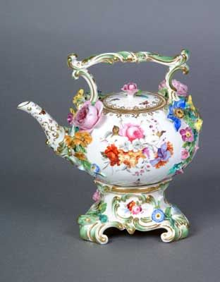 This floral-encrusted Coalbrookdale tea kettle was probably made for show, as the flower petals were very fragile. It dates from c1825 to 1830.