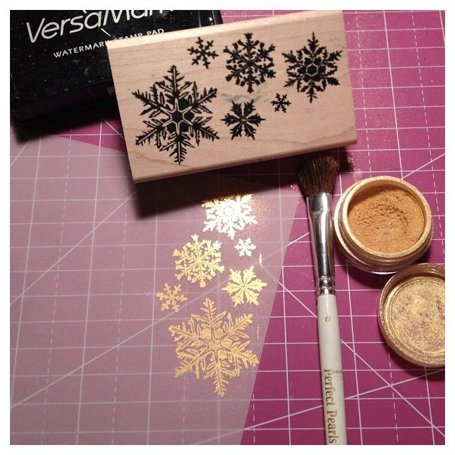 stamp on vellum, heat emboss in gold (more durable than perfect pearls pictured imo), stitch onto cardstock with some confetti or sequins behind it.