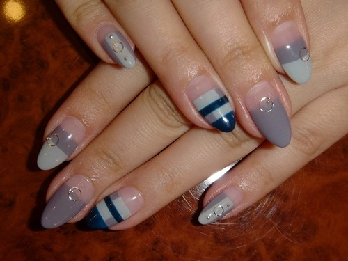 """One fashion trend that has always been a part of fashion is how women did their nails. The """"squoval"""" shape was the look that has been dominant for the past few years with young women and now because of celebrities like Rihanna and Lady Gaga the nail shape that is trending is the almonda shaped or stiletto. This shape was very poplular in the 80's and as most trends are coming back in style. With outrageous nail designs and colors, this style has been the dominant one as of lately. Jasmine B."""