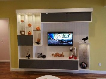 This Contemporary Unit Features A Neutral Palette With Gloss Textures Glass And Lighting California ClosetsCenter IdeasEntertainment