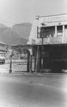 Haunting Black and white photograph of partially destroyed building in Longmarket Street, District Six. A store name - H. Levine - is visible in the picture  Location:  District Six  City:  Cape Town  Province:  Western Cape  Country:  South Africa. District Six Museum  Image number:  APN253571  Title:  H. Levine