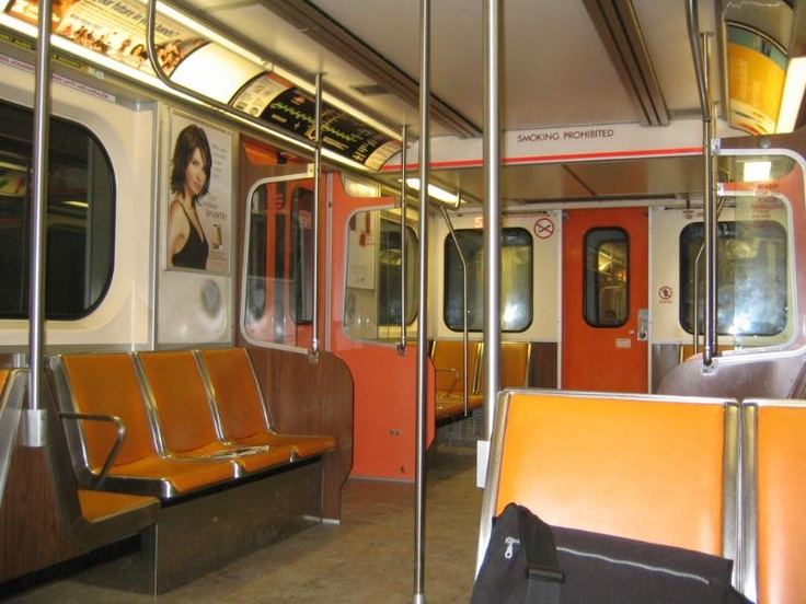 Inside a REALLY old Toronto Transit Commission (TTC) subway car. These trains didn't even have air conditioning!