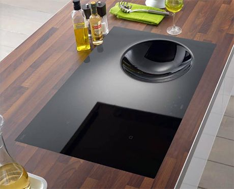 Flat top stove with built in wok. My dream kitchen will have this.