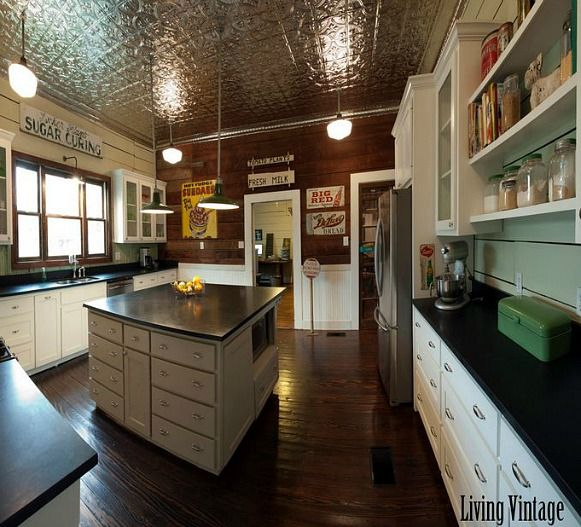 Kim's kitchen didn't look too bad to begin with, but it had a few strikes against it. For one thing, the tile countertops were a pain to keep clean. She knew there were original hardwood floors und...