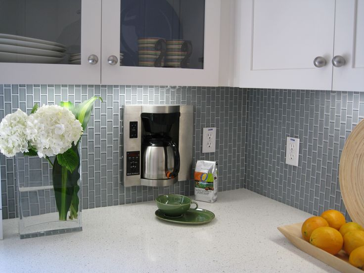 Swank Grey Glass Subway Tile For BackSplash Also Frozen Glass Floating Kitchen Cabinet With White Color Ornaments Also White Marble CounterTop And White Flowers At Unique Vase Glass At Contemporary Kitchen Design