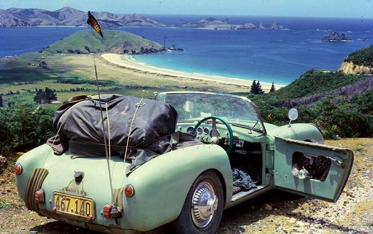 A Berkeley sports car is parked up at the lookout overlooking Matauri Bay & Motukawanui Island (north of Keri Keri in the far north) circa 1960-64    Berkeley Cars were produced in the UK, this one looks like a Berkeley Sports SE492 as it has internal door hinges, the SE492 had a 492 cc transverse two stroke three cylinder, air-cooled engine producing 30bhp and weighed around 300 odd Kg, 666 of this model were produced.   Touring on Northland's gravel roads must have been exciting in this…