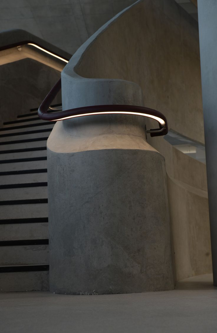 The Light Lab designed bespoke leather LED handrail for the helical style stairway at Hiscox, York.