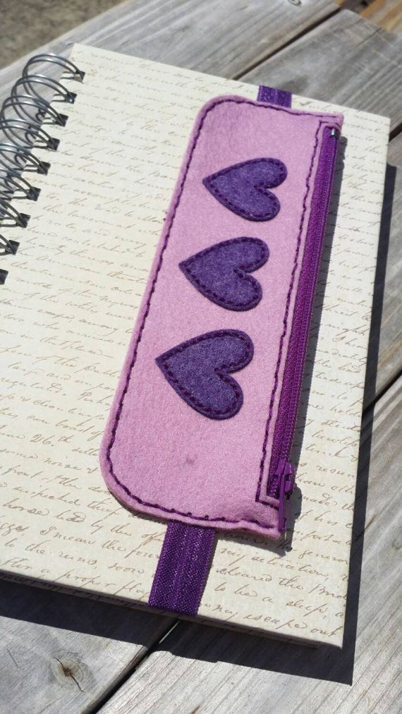 Check out this item in my Etsy shop https://www.etsy.com/listing/245738038/purple-hearts-pen-and-pencil-bookmark