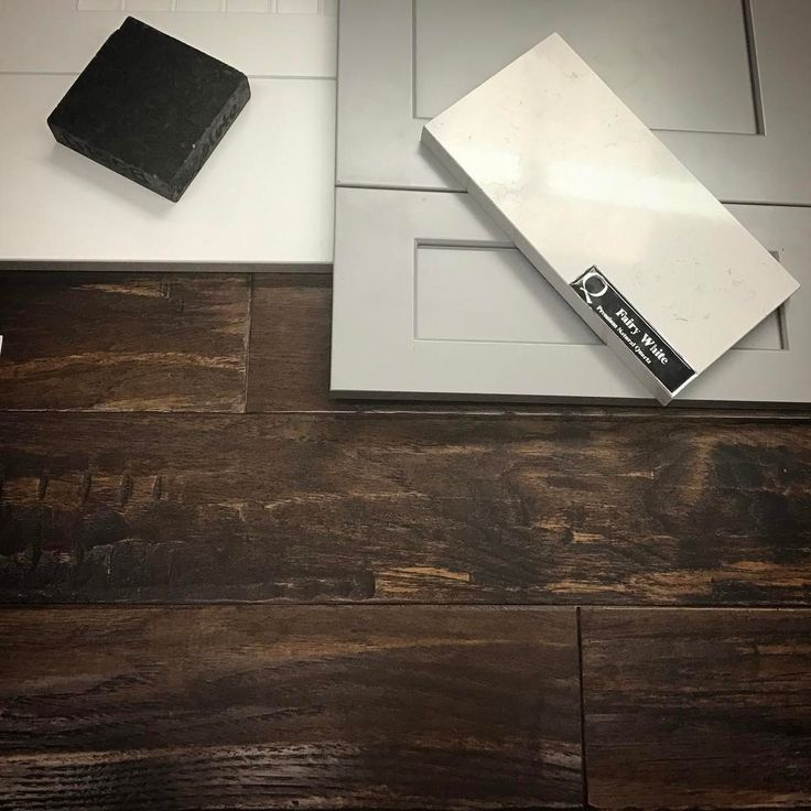 Farmhouse kitchen colors: cabinets, counters and floors...Hand scraped hickory hardwood (5 inch width) Grey island, white outer cabinets (all shaker style,) black honed granite for the outer counter tops, and a white quartz with white veining for the island...I may be in love!! <3