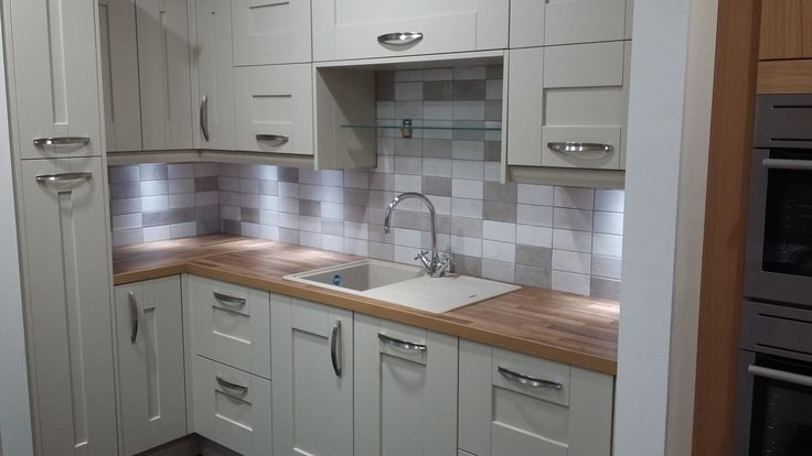 BY DESIGN Rye Painted Timber Shaker Kitchen with Bow handles & Composite Sink in our Torquay Showroom, Devon
