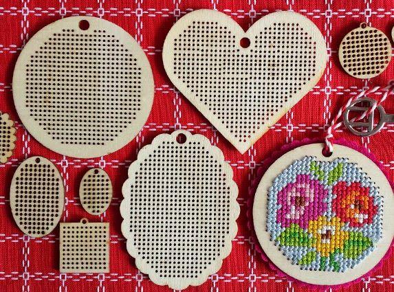 Cross stitch embroidery on wooden pendant. Doesn't it look great? By Handwerkjuffie.