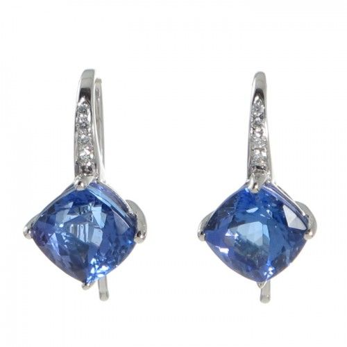 A pair of 9ct white gold short drop earrings featuring a pair of cushion cut tanzanites totaling 2.94ct in weight each set in four corner claws above a railed gallery each surmounted by a finely tapered hook at one corner with four graduated diamonds set to the front. #Rutherford #Melbourne