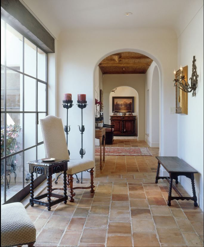 Beautiful hallway with saltillo tile and floor to ceiling window.