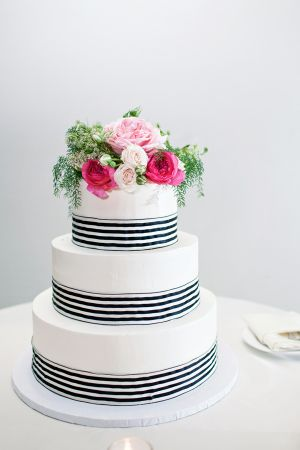 Round Wedding Cake With Pink Flowers and Navy and White Striped Ribbon | photography by www.tyrableek.com/