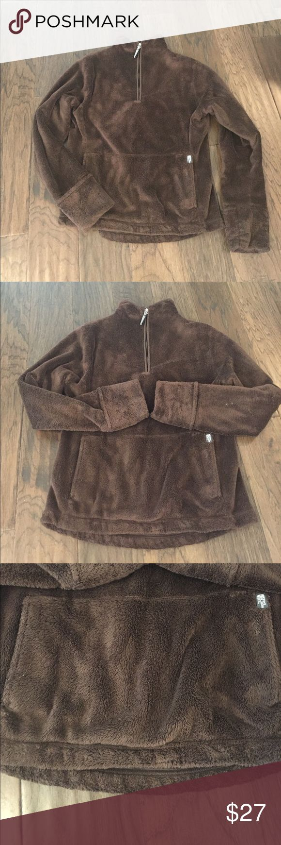 North Face Pullover Brown 1/4 zip Pullover from The North Face. Hoodie pocket in front. Rolled sleeves. Great condition. Size small Tops Sweatshirts & Hoodies