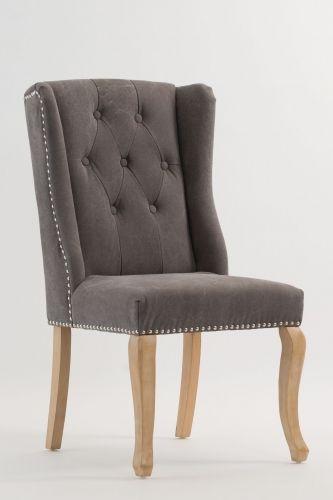Lekker og klassisk Siena spisestol i kanvasgrå med vinger, nagler og knapper.