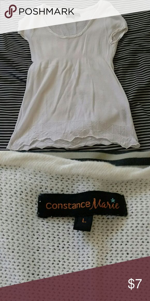 White top This top is a size large, but I'm usually a size medium and it fits me perfectly. Depends on your body type. The material is slightly see-through, so it can be worn over another top. Constance Marie Tops Tees - Short Sleeve
