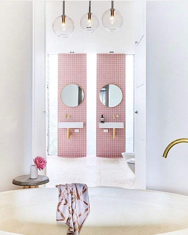 Loving this #pink-themed #bathroom designed by @thestyleschool! The pink is a nice pop of color against all the neutrals without being too saccharine. \\\ photo by @jamesgeer, styling by @aimeestylist