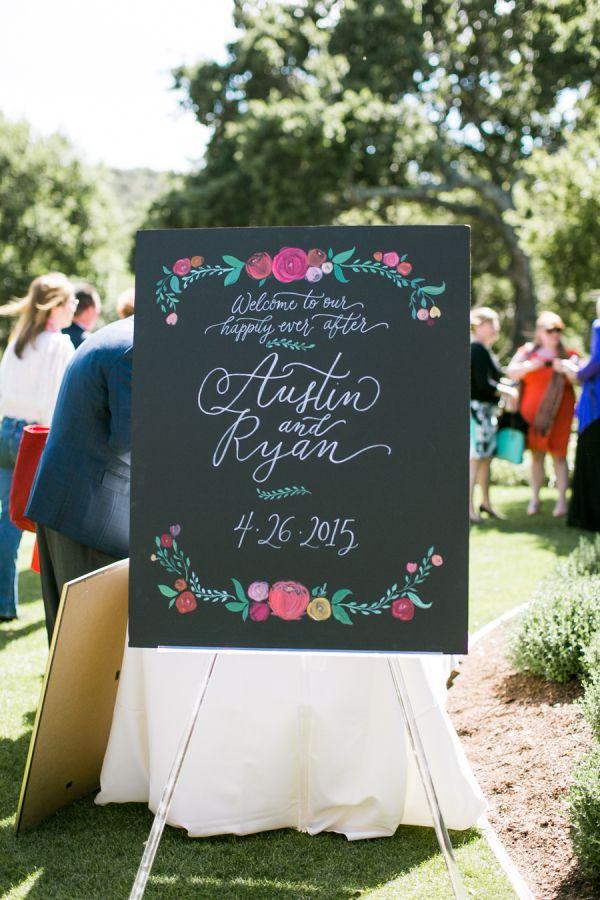 Colorful floral chalkboard wedding sign: http://www.stylemepretty.com/california-weddings/carmel-valley/2015/11/25/rustic-romantic-holman-ranch-wedding/ | Photography: Jasmine Lee - http://jasmineleephotography.com/index3/