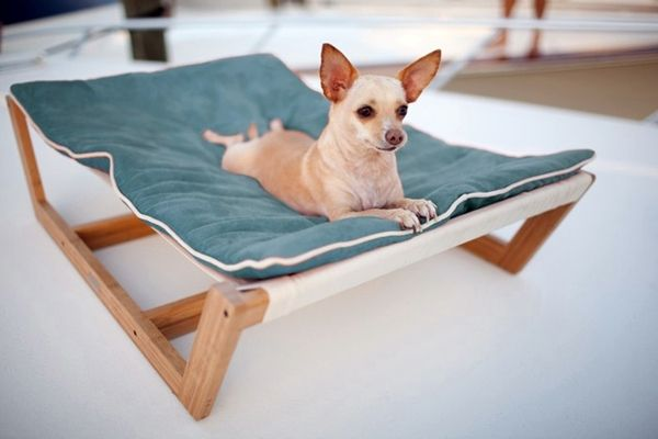 Dog/ pet hammock -- This unique pet hammock is suitable for cats and dogs of small to medium size. The bamboo cross frame is very strong and it has a removable and reversible ultra-suede cushion. The cushion is stain resistant and hypo-allergenic. This hammock is a luxury experience for your beloved pet.