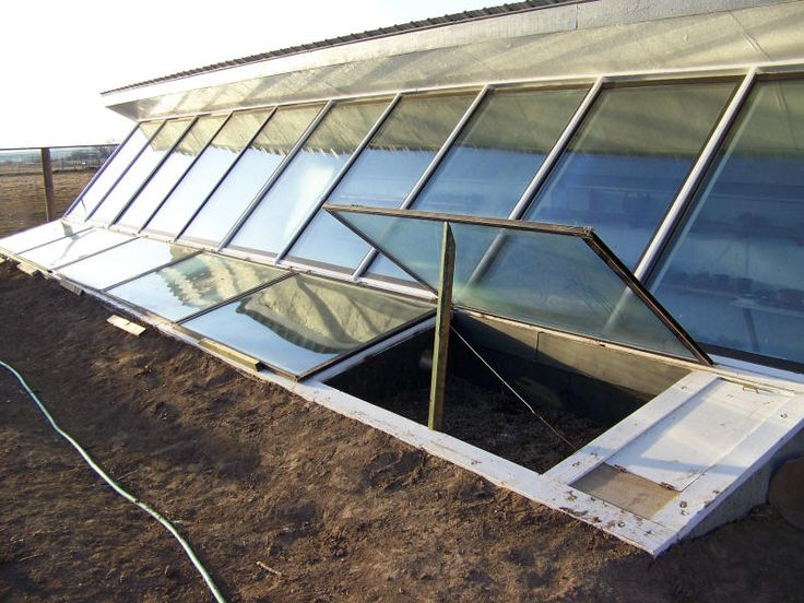 earth bermed sunken solar greenhouse with cold frames in front - Earth Sheltered Greenhouse Plans
