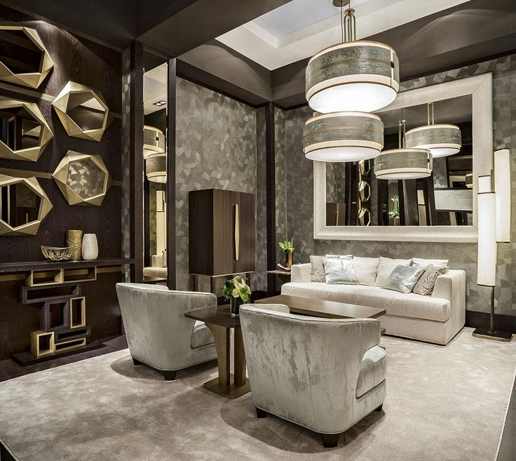 The Jade Lagoon room by Oasis, featuring two Joelle armchairs, a Brando sofa, the Gemini small table and the Ilo coffee table; on the wall, some Calliope mirrors. The Genga console is perfect for passageways, and the Laurent liquor cabinet is the best expression of the italian handcrafting.