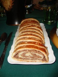 Hungarian Walnut Roll Recipe (Thanks to Fine Cooking) This is something you will see at all Christmas Markets, and on every family table after the main course around Christmas time. It is a delicious, slightly crumbly, sliced roll, kept moist by the great filling (walnuts paste or sometimes ground poppy seeds)